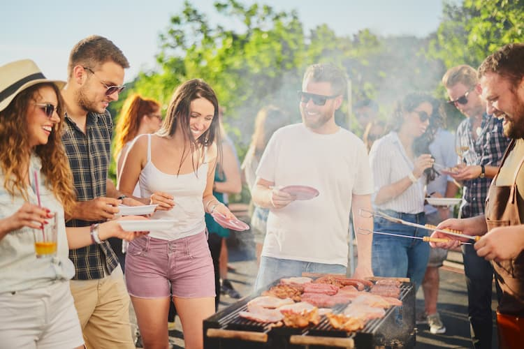 friends have a cookout with fresh food in a Dallas park on Memorial Day Weekend