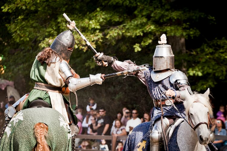 knights have a sword fight on horses at the scarborough renaissance festival