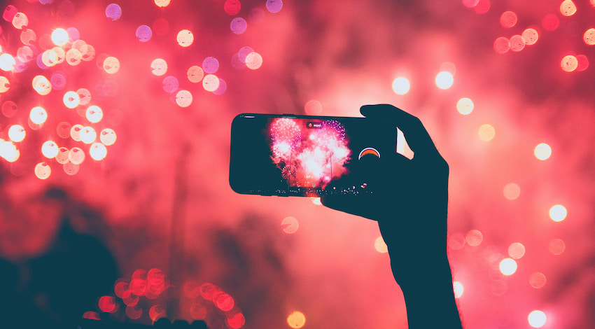 a cell phone takes a photo of a fireworks show in Austin, Texas