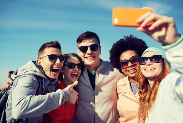 People taking group picture outside