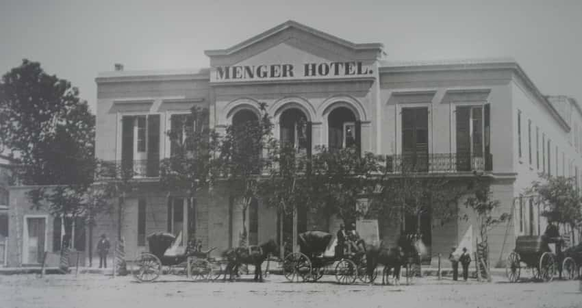 Black and grey historic photo of of the Menger Hotel from 1865.