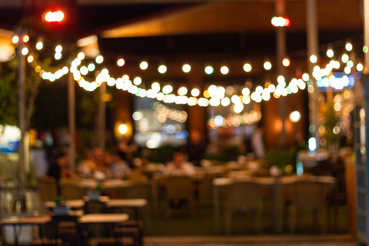 a blurry view of a patio with string lights