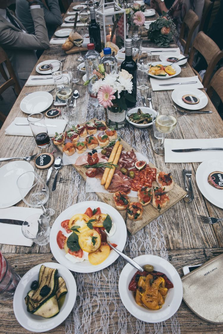 a table full of plates of food