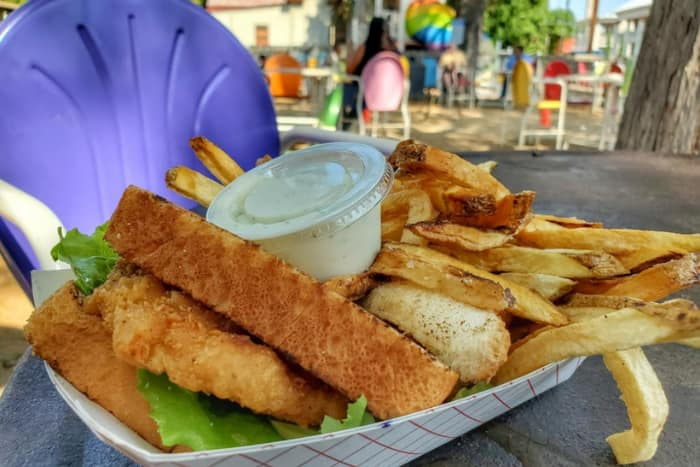 texas toast and french fries in a basket on an outdoor table