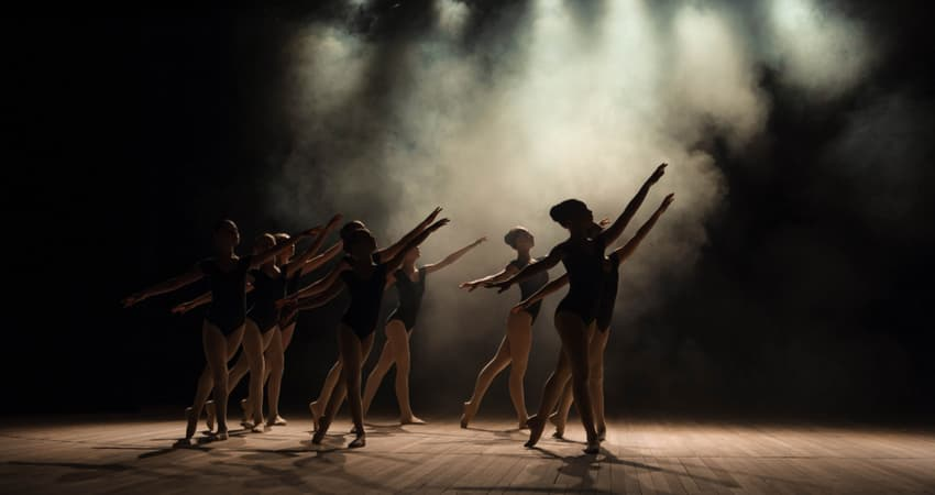 A group of ballet dancers silhouettes on stage